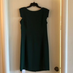 Green dress with cap sleeves.